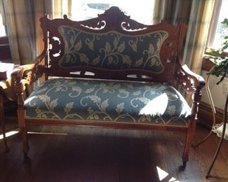 A old settee from the Goodman company in Cleveland. Nicely refinished.