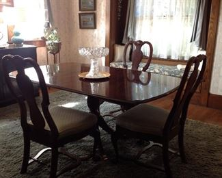 Dark Mahogany table with 6 chairs. A matching china hutch. This dining set is not real large.
