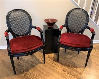 Pair of black painted cane and scarlet plush upholstery chairs. Details and pricing will be available on November 19th after 6 p.m. at https://shop.mlestatesales.com