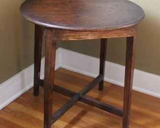"""#10.  $40.00. Oak side table with cross base 24""""h X 24""""diameter.  Finish issues."""