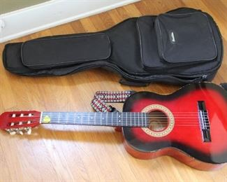 #15.  $75.00.  Sunlite 6 string acoustic guitar with case