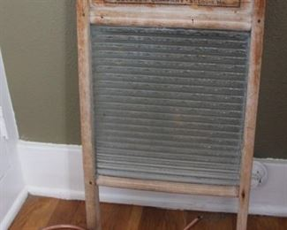 #18.  25.00. Glass front washboard with copper water can