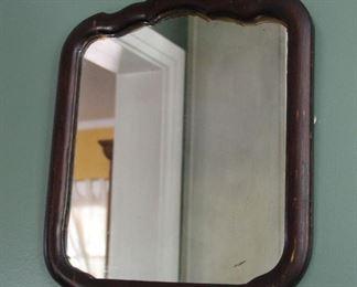 """#27.  $75.00. Wooden framed mirror dark wood 18"""" X 16"""""""