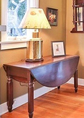 """#8.  125.00. Drop leaf table 27.5""""h  X 49.5""""w with leaves up X 42""""d with leaves down 19.5 Note:  table lamp is not for sale."""