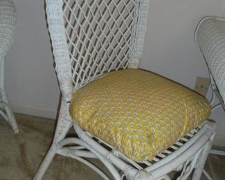 Matching white wicker chair