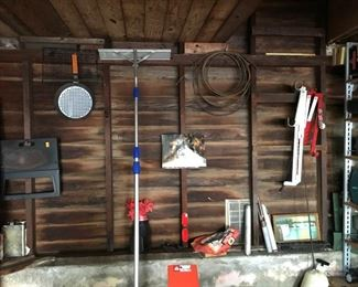 Estate lot, garage items including fishing poles, roof rake, decorative items, being sold as found at the estate.