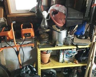 Estate garage lot including tools, tool bags, ladders, lights, floor lamp, hand saws, etc.