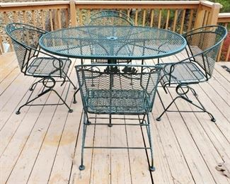Wrought Iron Oval Patio Table With Matching Spring Loaded Chairs, Qty 4, Table Measures 29.5in x 54in x 42in
