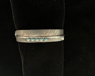 $100 (now $50) sterling and turquoise 'feather' cuff, hallmark DB