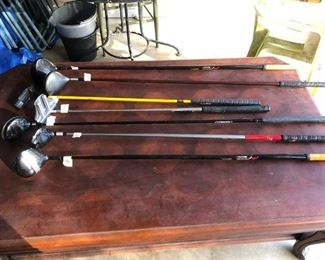 Large coffee table & golf clubs