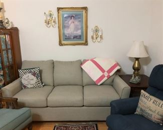 Living room couch, recliner, vintage quilt, end table