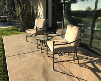 Cast patio chairs and table. Estimate $1200