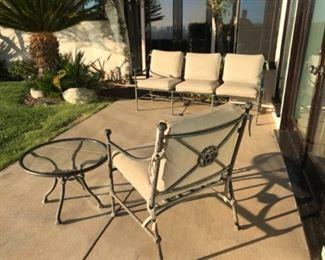 3 piece cast patio set. Estimate $1500