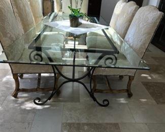 "Glass top table, 113"" x 50"". Estimate $4500"