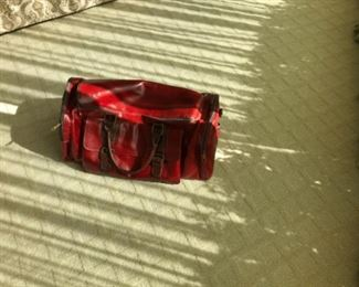 Leather bag with small blemish. Estimate $500