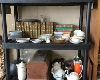 Ruby red glass, books,teapots