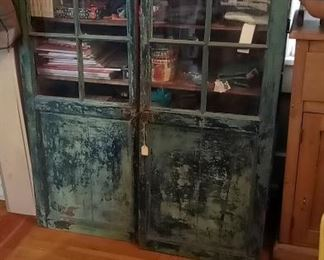 antique cupboard shown with glass doors