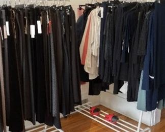 just two of the many racks of modern, simple clothing