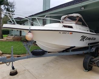 Mako 230 Boat EVINRUDE VRO 225 Motor with Clear Title and trailer, Boat 1991 26 ft Mako 230 Evinrude 225 V6 VRO motor, sleeper cabin, walk around deck, outriggers, transit controls, 2- 6 ft fish boxes, 350 running hours on it, galvanized trailer with breaking system.  Engine needs flywheel and stator 1,200. quoted fix with parts and labor.