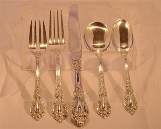"PRICE REDUCED!!  GORGEOUS VINTAGE LUNT STERLING SILVER ""ELOQUENCE"", SERVICE FOR 9 FLATWARE SET. INCLUDES A 5 PIECE PLACE SETTING AS SHOWN (NOTE: ONE SOUP SPOON IS BENT) TOTAL WEIGHT 1735g. OUR PRICE IS $2400.00"