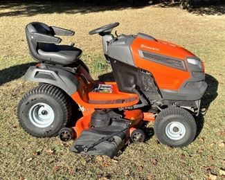 """LIKE NEW HUSQVARNA MODEL YTH-24K48 RIDING MOWER WITH ONLY 130HRS ON ITS 24HP KOHLER ENGINE WITH 48"""" CUT AND SMOOTH HYDROSTATIC DRIVE. ABOUT AS CLOSE TO NEW AS THEY GET."""