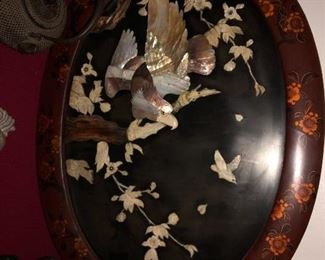 One of a pair of mother of pearl and lacquer large plaques