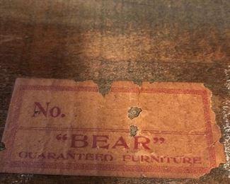 Label on the bottom of drawer of mission oak desk. Bear guaranteed furniture
