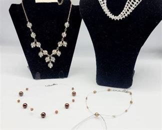 4 Necklaces and One Pair of Earrings