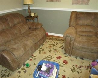 stressed leather reclining love seat and matching recliner