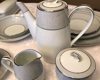 Noritake china. serving for 12. Pretty grey and white.