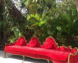 Vintage Victorian French Baroque Carved wood red velvet sofa.