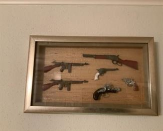 Old Miniature Toy Guns Framed In Shadow Box