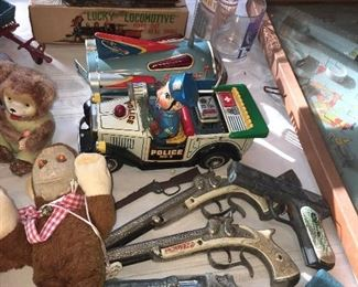 toy cap guns, like new wind up tin toys, and lots of Steiff stuffed animals