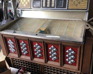 AMI mid century jukebox.  Dozens of classic 45's to fill it.