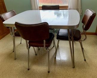 $150.00................Vintage Kitchen Formica Table, one leaf 4 chairs, great condition  (P238)