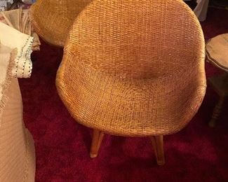 Mid century wicker chairs purchased in Hawaii.  Not much wear and display very nicely $500 each