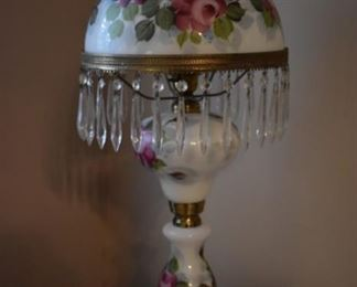 Beautiful Antique Lamp, hand painted with very unusual porcelain and glass base combination . Shade is accented with crystal prisms.