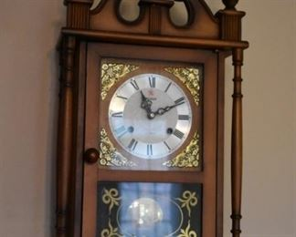 Mantle Clock adorned with Pontiels and Gold-Filigree Corners on Face of Clock