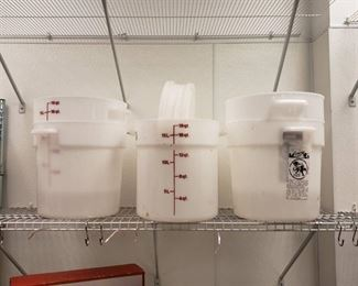 Lot plastic containers on shelf