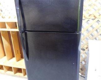 Black Frigidaire refrigerator 65 10/16in H X 30in W X 30in D