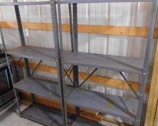 2 blue metal storage racks with 4 shelves- both are 61in H X 30 1/2in W X 12in D