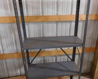 Blue metal storage rack with 4 shelves 61in H X 30 1/2in W X 12in D