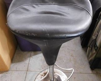 Swivel bar stool with leather cushioned seat