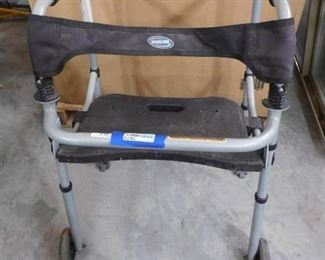 Invacare medical walker has wheels and seat