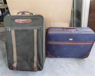 2 Suitcases both have wheels