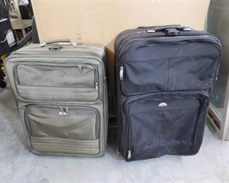 2 Large suitcases both have wheels