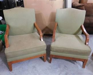 Pair of two green office lounge chairs with wooden arm rests