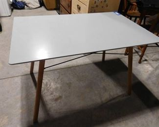 Modern wooden table with minor scratch and chip 27 1/2 H X 43 1/2 X 27 1/2 D