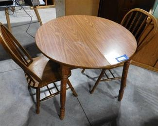 Small dinning table with 2 matching chairs 29in H X 36in dia. ( some water damage )