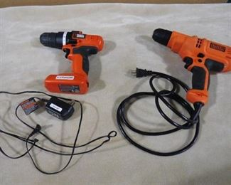 2 Black & Decker power drills one with cord other with charger